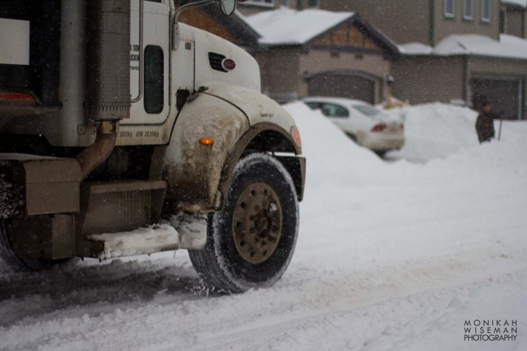 Truck in snow with shoveller